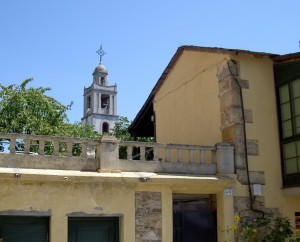 The spire of Petin church peers down on the village